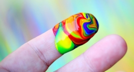 Canva-Person-Showing-Multi-coloured-Paint-On-His-Index-Finger-980x408 2